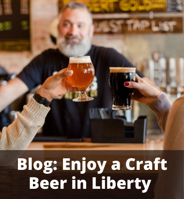 Blog - Enjoy a craft beer in Liberty - Two people cheers-ing at a bar