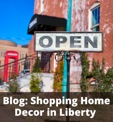 Image of a store front with an open sign. Text - Blog: Shopping Home Decor in Liberty
